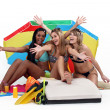 Friends sitting under a beach umbrella — Stock Photo