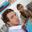 Male and female students in library — Stock Photo #10094440