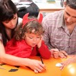 Parents with children dressed as devil — Stock Photo
