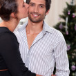 Foto de Stock  : Couple kissing at Christmas