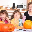 Funny Kids carving pumpkins — Stock Photo
