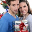 Stock Photo: Couple exchanging Christmas gifts