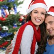 Young couple celebrating Christmas — Stock Photo #10095404