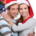 joven pareja en Navidad — Foto de Stock