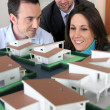 Architect showing model housing to customers — Stock Photo