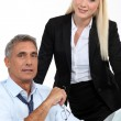 Architect and his assistant with plans and a 3D model — Stock Photo #10096069