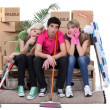 Royalty-Free Stock Photo: Tired roommates on moving day