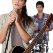 Stock Photo: Brunette with microphone rehearsing