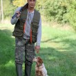 Hunter and dog - Stock Photo