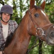Teen riding horse — Stock Photo #10096959