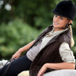 Blond teen riding her horse — Stock Photo #10096985