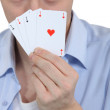 Man with four ACES — Stock Photo #10097129
