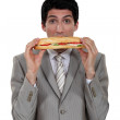 Stock Photo: Businessmeating yummy sandwich