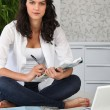 Stock Photo: Young woman working at home