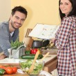 Couple preparing home cooked meal — Stock Photo