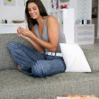 Woman chilling-out on sofa - Stockfoto