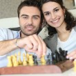 Couple playing chess — Stock Photo #10098814
