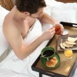 Mhaving breakfast in bed alone — Stock Photo #10099142