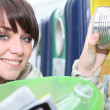 Brunette recycling — Stock Photo