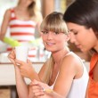 Girls having breakfast - Stock Photo