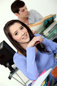 Young student in classroom — Stock Photo