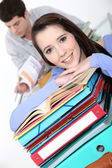 Oblique image of students with folders — Stock Photo