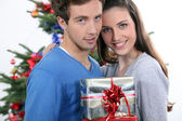 Couple exchanging Christmas gifts — Stock Photo