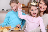 Woman and little girls celebrating Epiphany — Stock Photo