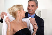 Woman placing scarf on woman — Stock Photo