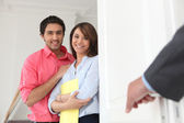 Young couple with an estate agent — Stock Photo