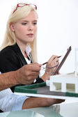 Blonde woman taking notes — Stock Photo