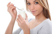 Woman eating yogurt — Stock Photo