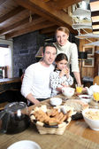 Young family gathered in the kitchen — Stock Photo