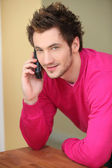 Man making a call from home — Stock Photo