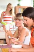 Girls having breakfast — Stock Photo