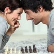 Couple playing chess — Stock Photo #10100228