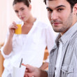 Couple with morning drinks - Foto Stock