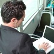 Businessman in the bus working on his laptop — Stock Photo