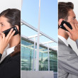 Stock Photo: Two businesspeople using their mobile telephones