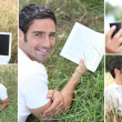 Man listening to music outdoors via laptop — Stock Photo