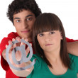 Boy and girl holding the at symbol — Stock Photo