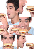 Young man eating a hamburger — Stock Photo