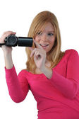 Woman filming with video camera — Stock Photo