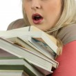 Young woman overworked with a stack of books — Stock Photo