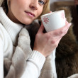 Blond woman holding a mug of coffee — Stock Photo