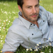 Man relaxing in field — Stock Photo #10119194