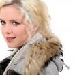 Blonde girl with fur hood — Stock Photo