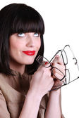 Woman with many pairs of glasses — Stock Photo
