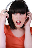 Brunette wearing headphones — Stock Photo