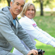 Couple biking — Stock Photo